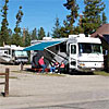 Hideaway RV Park - In Town Solitude - An intimate and quiet RV park within walking distance of Yellowstone. All sites have full hook-ups/cable TV, clean showers and accepts pets. Dining & stores nearby.