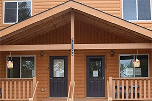 Pine Shadows 2-Bdrm Condominiums :: Nearly-new condos. Comfortable year-round cabin-style accommodations for groups (up to 8) with kitchens, fireplace and separate bedrooms. BOOK DIRECT ONLINE and save.